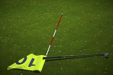 Yellow Flag Hole Marker At The Golf Course Royalty Free Stock Photography