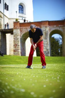 Free Man Golfer Putting On A Green With Castle Royalty Free Stock Images - 14513769