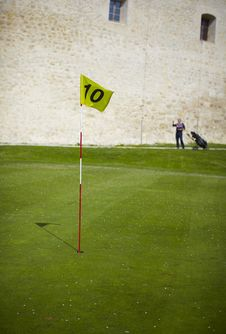 Yellow Flag Hole Marker At The Golf Course Royalty Free Stock Images