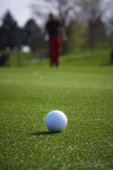 Golf Ball Close-up With Golfer Man Stock Image