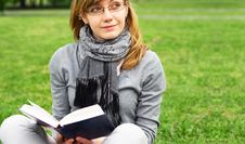 Free The Girl Sits On A Grass, Reads The Book Stock Photography - 14514652