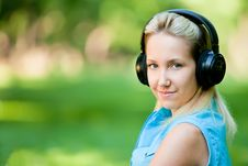 Girl Listening Music On Headphones