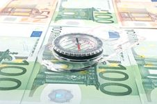 Currency And Compass Stock Photo