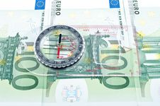 Currency And Compass Royalty Free Stock Images