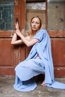 Free Blonde In Blue Tunic Near Door Royalty Free Stock Photography - 14518007