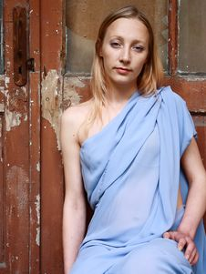 Free Beautiful Blonde In Blue Tunic Near Door Royalty Free Stock Photos - 14518048