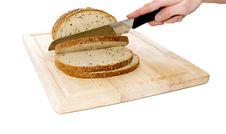 Free Bread Cut By Knife On Kitchen Board Stock Image - 14519731