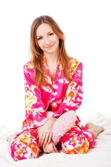 Free Sweet Young Girl In Pink Pajamas On Bed Stock Image - 14521831