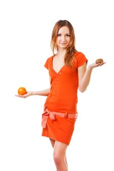 Young Pretty Girl In Dress With Orange And Kiwi Stock Photography