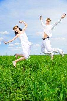 Free Couple Jump In A Flower Field Stock Image - 14523621