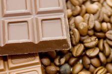 Background From Coffee Beans And Chocolate Royalty Free Stock Photos