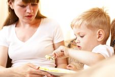 Free Mother Feeding Her Son Royalty Free Stock Photography - 14525037