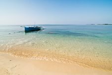 Blue Wooden Boat On A Pristine Beach Royalty Free Stock Photography