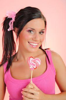 Free Beautiful Teenage Girl With A Lollipop Stock Photography - 14528802