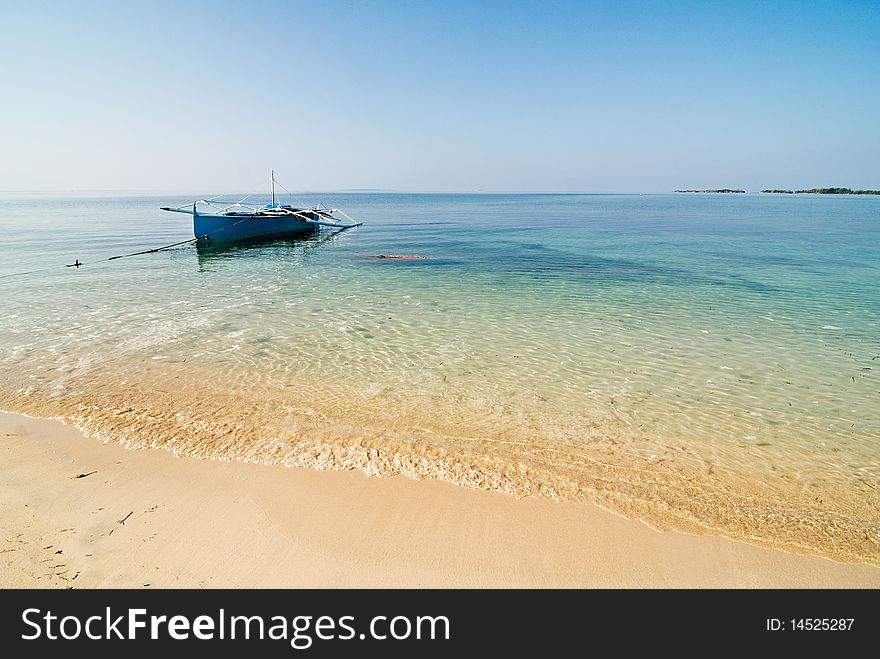 Blue Wooden Boat on a Pristine Beach