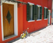 Free The Red House Wall And Yellow сhildren S Bicycle Stock Photo - 14533230