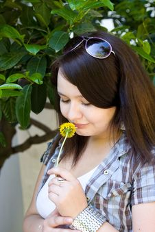 Free Young Girl Sniffs A Dandelion Royalty Free Stock Images - 14535129