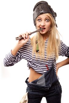 Woman And Wrench Royalty Free Stock Photo