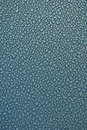Free Dew Drops On Blue Metallic Surface Royalty Free Stock Photo - 14545875