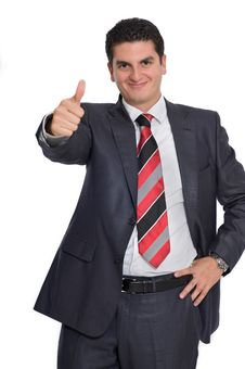 Young Businessman Giving A Thumbs Up Royalty Free Stock Photo
