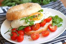Bagel With Egg And Tomatoes Stock Photo