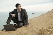 Businessman At The Beach Royalty Free Stock Image