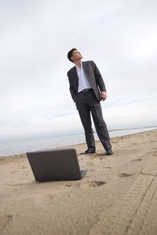 Guy In A Suit On The Beach Stock Image