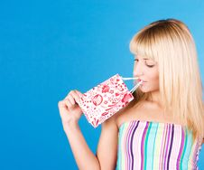Free Beautiful Blonde Looks At The Package Royalty Free Stock Photo - 14550215