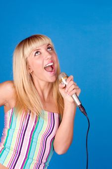 Free Sweet Blonde Sings Into A Microphone Royalty Free Stock Photo - 14550505