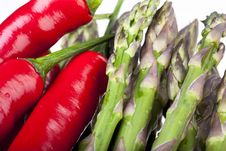 Free Raw Hot Peppers And Asparagus Royalty Free Stock Photos - 14550688