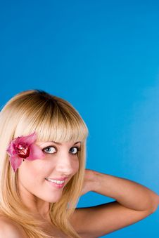 Cute Blonde With An Orchid In Her Hair Stock Photography