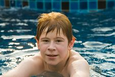Boy With Red Hair In Pool Royalty Free Stock Photography