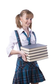 Schoolgirl With Stack Of Book. Royalty Free Stock Photography