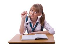Schoolgirl Doing Her Homework. Royalty Free Stock Images