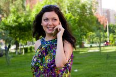Free Woman Is Talking Mobile Phone Outdoors. Stock Photography - 14556632