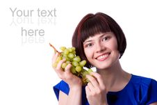 Woman Holding A Bunch Of Green Grapes Royalty Free Stock Photos
