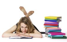 Girl Lying On Floor And Reading, Looking At Camera Stock Photo