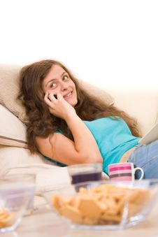 Attractive Young Girl Lying On Sofa Stock Image