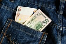 Euro And Dollar Banknotes In Jeans Pocket Royalty Free Stock Photography