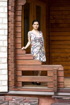 Girl  On A Veranda Royalty Free Stock Photo