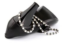 High Heels Shoe And Beads Royalty Free Stock Photos
