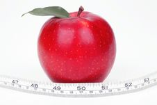 Red Apple And Measuring Tape Stock Images