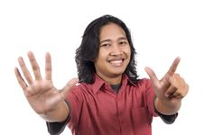 Free Long Hair Man Give Number Seven By Hand Gesture Stock Photography - 14560232