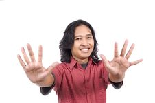 Long Hair Man Give Number Ten By Hand Gesture Royalty Free Stock Photos