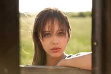 Image Of Beautiful Teenager Taken Through Tin Shed Royalty Free Stock Photos