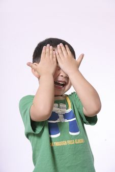 Free Laughing Boy Covering Face With Hands Royalty Free Stock Photo - 14566605