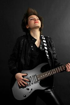 Free Rock Girl In Leather Outfit With Electric Guitar Royalty Free Stock Image - 14566706