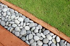 Round Stone And Grass Royalty Free Stock Photo