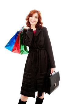 Young Woman With Briefcase And Shopping Bags Royalty Free Stock Photo