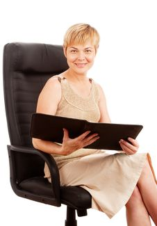 Free Woman With Folder In Armchair Royalty Free Stock Photos - 14570338